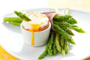 Boiled eggs with ham-wrapped asparagus soldiers